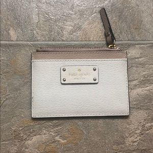 White and nude card holder from Kate Spade